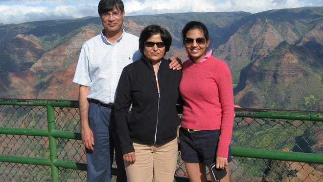 Nirali Shah will be climbing Mt. Kilimanjaro in Tanzania to raise money and awareness for ALS, the disease that her mother died of in 2015. She is pictured (right) here with her late mother Sonal (middle) and her father Nirmal (left).