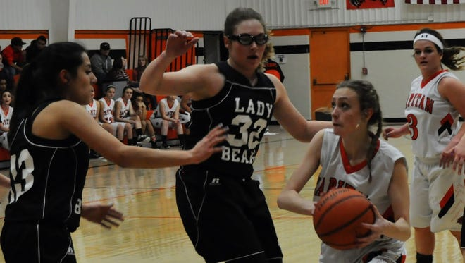 Capitan's Kara Vallance takes the ball to the basket against Cloudcroft in the first round of the Smokey Bear Tournament Thursday.