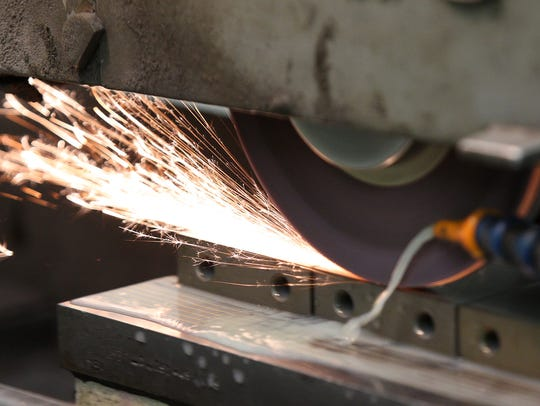 Dave Lash-Steier works on a surface grinder at Monsees
