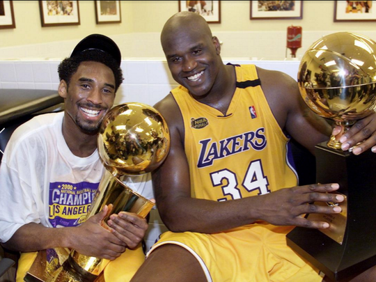 Kobe Bryant won the first of five NBA Championships, all with the Lakers, in 2000. Here, he's posing with MVP Shaquille O'Neal after winning the championship on June 19, 2000.