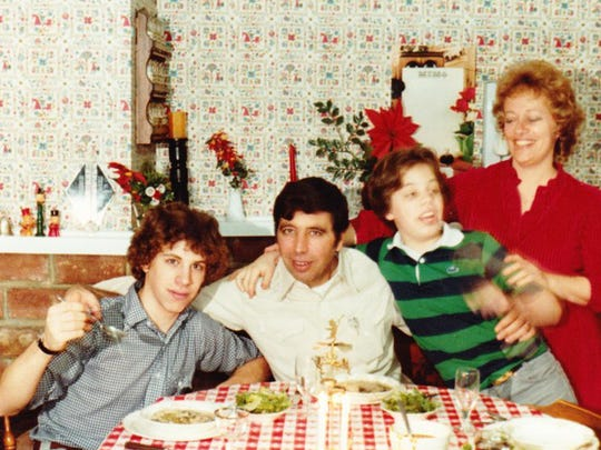 Joe and Barbara Giancola with their sons Peter and Daniel enjoying Mama's cooking.