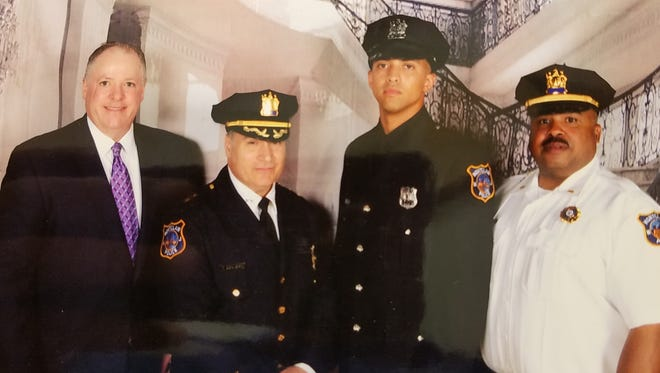 Montclair Township Manager Timothy Stafford, left, Police Chief Todd Conforti, second from left and Lieutenant Tyrone Williams, right, attended the graduation ceremony of Montclair Police Officer Jeffrey D. Beckett, second from right, from the Essex County College Public Safety Academy on June 13.