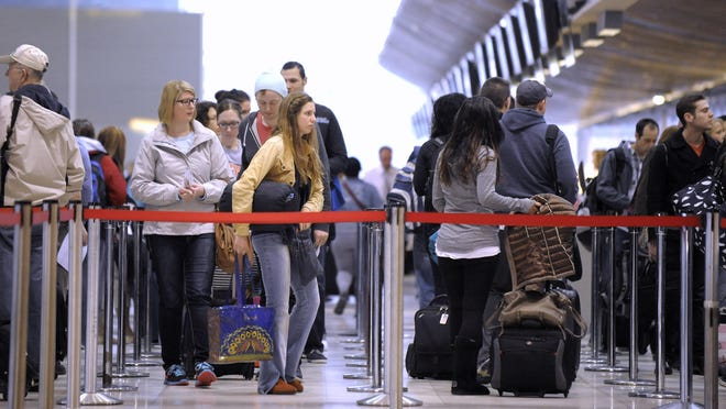 With the increase in passengers at Detroit Metropolitan Airport come longer wait times to get to the gates. If the travel trend continues this year, the airport could come close to the passenger record set in 2005.