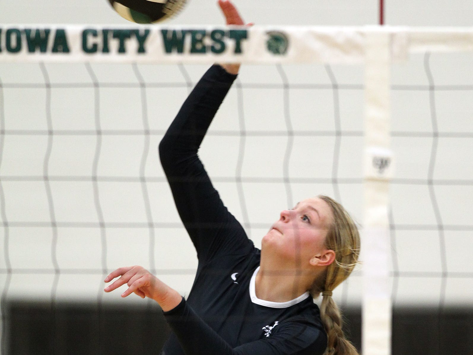 City High's Shannon James goes for a kill during the Little Hawks' regional semifinal game at West High on Thursday, Oct. 29, 2015.