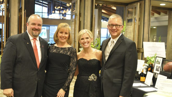 Ministry Saint Michael's Hospital board member Jeff Whitrock, from left, and wife Lisa along with Saint Michael's Foundation Director Angie Heuck and husband Mark Hilliker pause for a photo while considering silent auction items at the 2014 Gala for Giving.