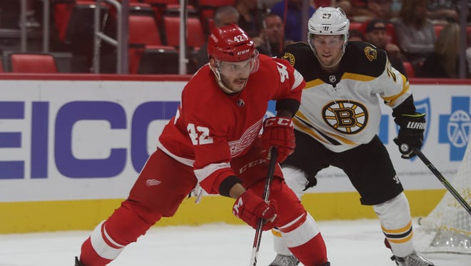 Detroit Red Wings' Martin Frk moves the puck against the Boston Bruins Austin Czarnik during the first period Sept. 23, 2017 at Little Caesars Arena.