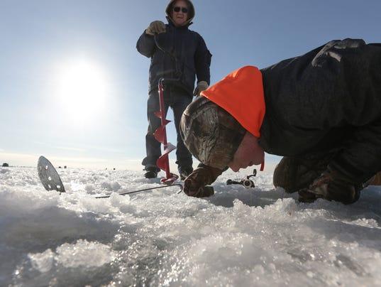 Deadline near to get ice fishing shanties off lake st clair for Lake st clair ice fishing