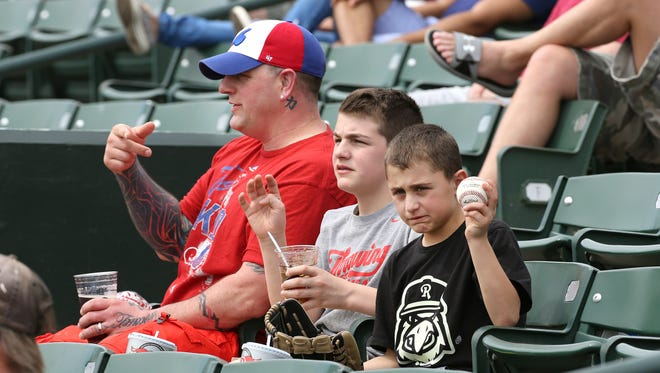 Brian  Germano and his sons, Ethan, 12 and  Blake, 10 (with glove), played hooky to attend a morning game at Frontier Field, where the Red Wings beat the Gwinnett Braves in dramatic fashion with a walk-off single in the 9th-inning.