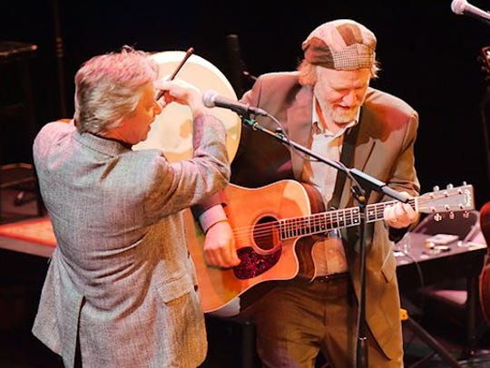 Paul Cotton, left, and Charlie Roth play during a Ring