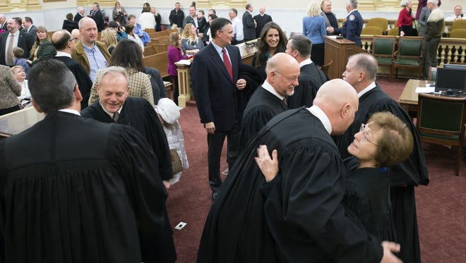 Judges mingle after the ceremony to administer the oath of office to court and county officials at the York County Administrative Center on Jan. 4. Two newly sworn-in common pleas judges, Chris Menges and Michael W. Flannelly, are now on the rotation to hear protection from abuse cases.