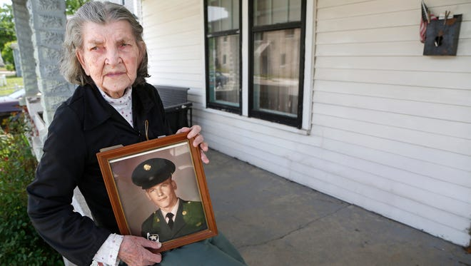 Marietta Noe holds a photograph of her late son, David Howard, Thursday, May 26, 2016, at her north side Lafayette home. Howard was killed in 1967 in action in Vietnam.