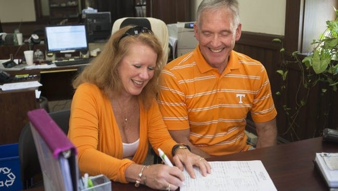 Mona Largent and Brent Akin obtain a marriage license Friday, Aug. 12, 2016, at the Knox County Courthouse. The couple will be married at Neyland Stadium Sept. 1 before the Tennessee's first home game.
