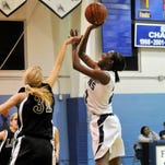 02/15/2011--Photo by Craig Bailey/FLORIDA TODAY--Florida Air Academy's Kemari Jones shoots over Shelby Salyerds of Father Lopez during their game Tuesday in Melbourne.