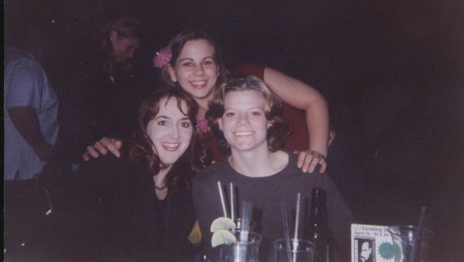 Teresa Halbach (far right, front) and friends at a comedy club in the early 2000s.