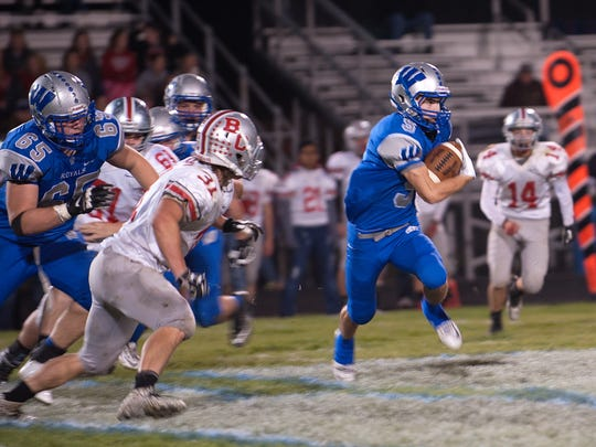 Cole Fortner runs with the ball during the Buckeye Central at Wynford game on Friday night. Wynford was winning at halftime, 21-0.