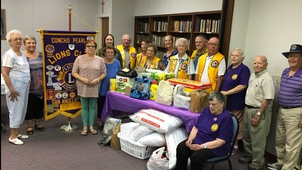 Members of the Concho Pearl Lions Club donate supplies to the San Angelo Family Shelter on Aug. 14.