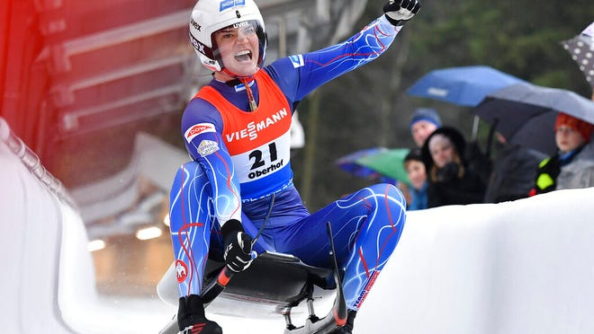 Summer Britcher from the USA cheers at the finish line after finishing third at the luge world cup in Oberhof, Germany, Sunday, Feb.2, 2020.