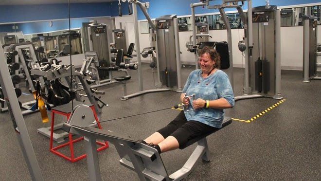 Laura Healy of Yreka works out at the Siskiyou Family YMCA in Yreka last Wednesday. She's happy to have her gym back open. While it was closed, she visited Greenhorn Park to take runs.