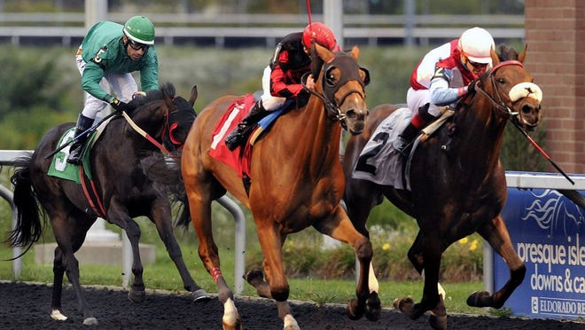From left, Fabledzapper, with Mike Allen aboard, Tiz a Par, ridden by Gilberto Ramos Delgado and Silver Dib, with Ronnie Allen, Jr. aboard, finish a race at Presque Isle Downs & Casino in Summit Township on Sept. 27, 2017. Presque Isle Downs and Casino is set to begin racing operations on July 27 as it plans 50 dates of competition. The season will finish on Oct. 22.