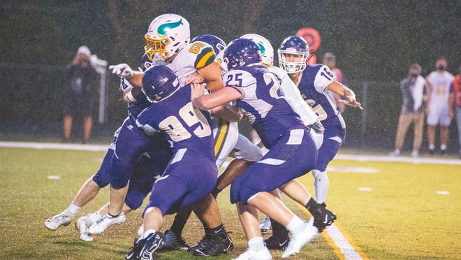 """Camdenton's """"Purple Haze"""" defense swarms to a Parkview ball carrier in a game against the Vikings on September 11 in Camdenton."""