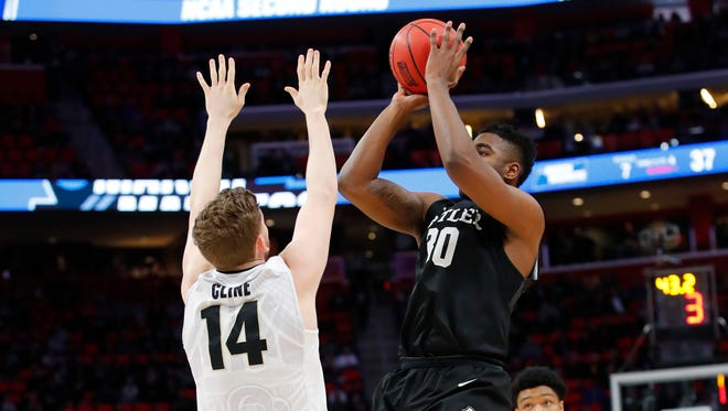 Bulldogs forward Kelan Martin (30) shoot over Purdue Boilermakers guard Ryan Cline (14) in the second round of the 2018 NCAA Tournament at Little Caesars Arena.