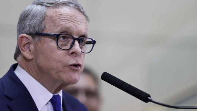 In this file photo, Ohio Gov. Mike DeWine gives an update at MetroHealth Medical Center on the state's preparedness and education efforts to limit the potential spread of a new virus, which causes a disease called COVID-19, Thursday, Feb. 27, 2020, in Cleveland.