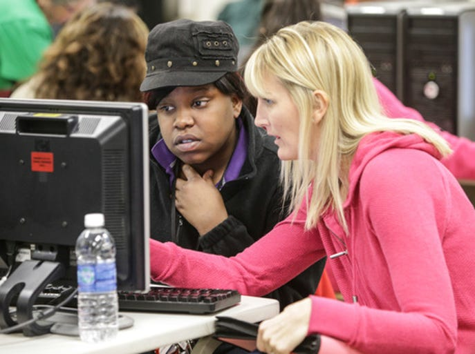 A college-bound student receives help applying for