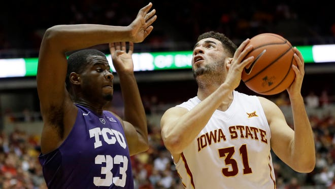 Iowa State forward Georges Niang, right, drives to the basket past TCU forward Chris Washburn, left, during the first half of an NCAA college basketball game, Saturday, Feb. 20, 2016, in Ames, Iowa.