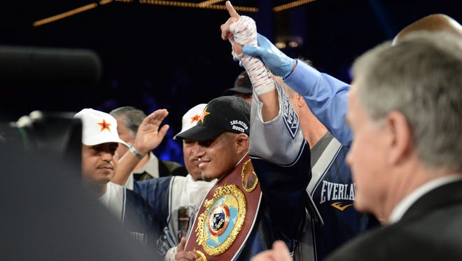 Mikey Garcia celebrates his win over Juan Carlos Burgos (not pictured) after their WBO junior lightweight title bout at The Theater at Madison Square Garden.