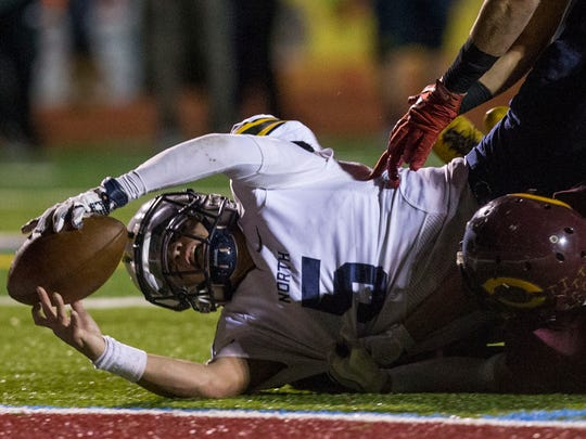 Toms River North's Mike Husni scores a touchdown in the first half.