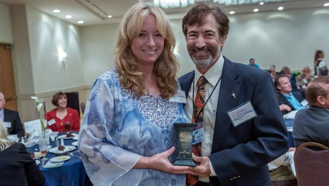 Angie and Joe Leggio, of MIS Consulting, receive the 2017-2018 Business of Character Award from the United Way of Martin County.
