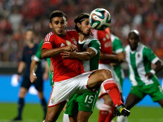 Benfica's Eduardo Salvio, left, from Argentina, vies for the ball with Rio Ave's Tiago Pinto during the Portuguese league soccer match between Benfica and Rio Ave at Benfica's Luz stadium in Lisbon, Portugal, Friday, Oct. 31, 2014. (AP Photo/Francisco Seco)