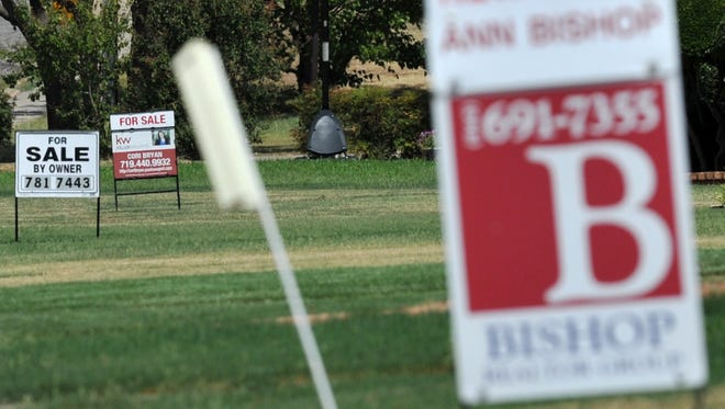 In this file photo, houses for sale signs are seen in the Wichita Falls' Tanglewood area. The Texas real estate market cooled slightly in August after a surge from pent-up demand. Housing sale prices are likely to remain high as the supply of single-family homes struggles to meet the demand.