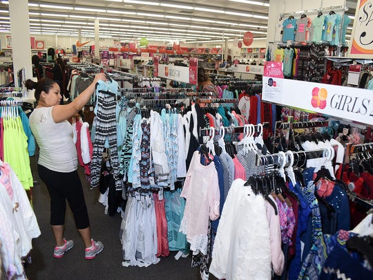 Dora Garrillo shops for her family at the Stage department store in Farmington on Thursday.