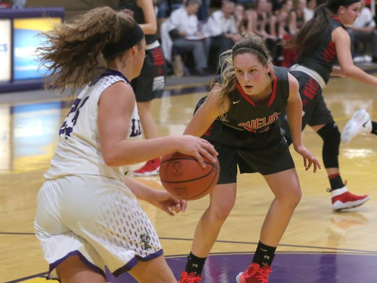 Shelby's CeCe Gurney defends against Lexington's Gabby Stover in Tuesday's basketball game.
