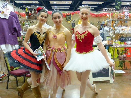 "Three ballerinas from ""The Nutcracker"" ballet helped"