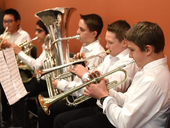 A brass quintet from Novi Middle School, including