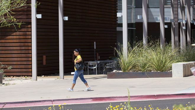 A student walks at Mesa Community College Red Mountain campus April 6, 2016.