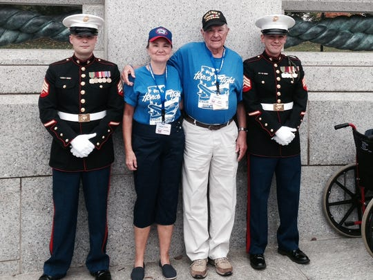Carl Cook poses with family members at the National World War II Memorial last year.