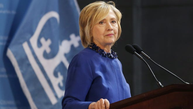 Hillary Rodham Clinton, a 2016 Democratic presidential contender, asks the audience to join her in praying for Baltimore during a speech Wednesday at Columbia University in New York.