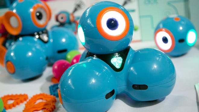 Kids can react with Dash, a robot from Wonder Workshop, in a variety of ways. Mark Lennihan/AP