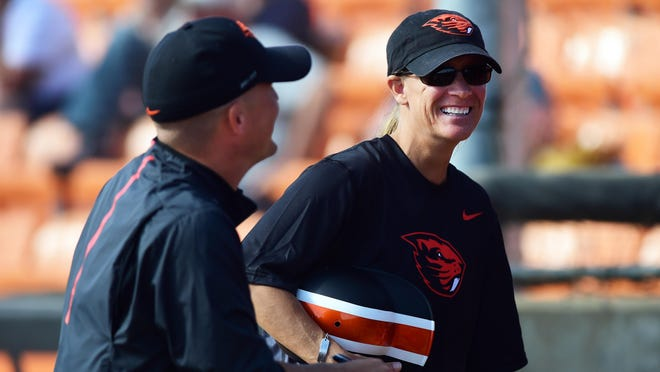 Oregon State head coach Laura Berg (right), with assistant coach Aaron Vail, is the most decorated USA Softball Olympic athlete in history.