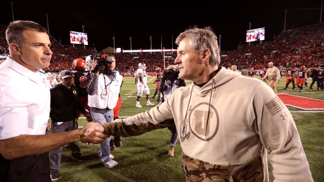 Utah coach Kyle Whittingham, here shaking hands with Oregon counterpart Mario Cristobal, will try to lead the Utes to the South Division title for the third consecutive season. (AP Photo/Rick Bowmer)