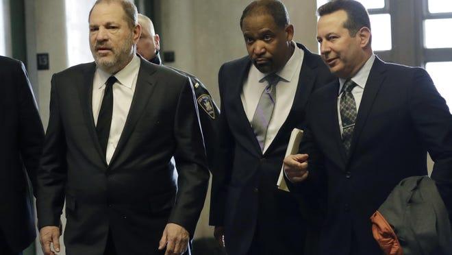 Harvey Weinstein, left, enters court with attorneys Ron Sullivan, center, and Jose Baez, Jan. 25, 2019, in New York.