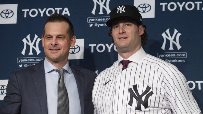 Yankees manager Aaron Boone, left, with Gerrit Cole at the press conference announcing the pitcher''s nine-year, $324 million contract. The addition of Cole has made the Yankees a World Series favorite for the 2020 season.
