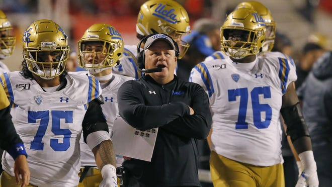 Chip Kellym, center, is entering his third season as UCLA's football coach.