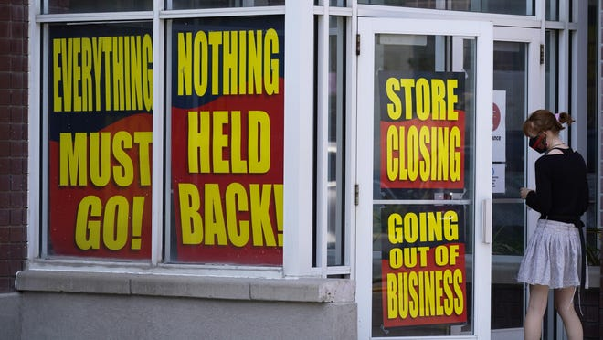 Store closing signs are shown on a Stein Mart store Sunday, Aug. 30, 2020, in Salt Lake City. The latest Federal Reserve survey of U.S. economic activity found generally modest gains in August but also pessimism about the future given the threats posed by the coronavirus.