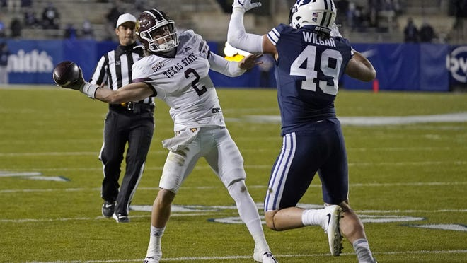 BYU linebacker Payton Wilgar (49) pressures Texas State quarterback Brady McBride (2) in the first half Saturday in Provo, Utah. McBride did a good job early, said head coach Jake Spavital about McBride versus BYU, but the quarterback needs to clean up some things.