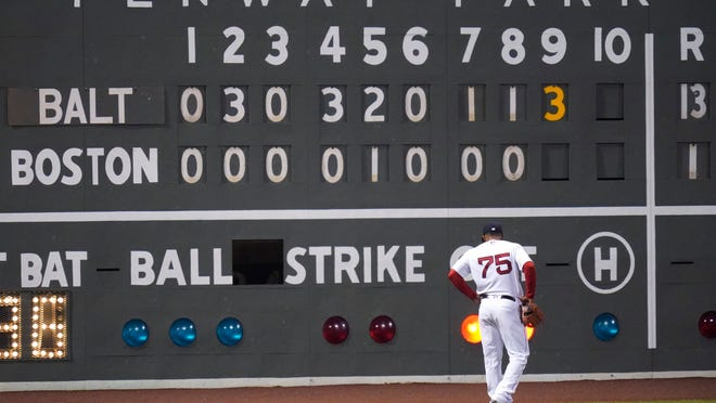 Red Sox prospect Cesar Puello walks toward the scoreboard in left field on Sept. 24 before the team wrapped up its dismal season. As a result, Boston will have the fourth ovreall pick in this year's MLB draft.