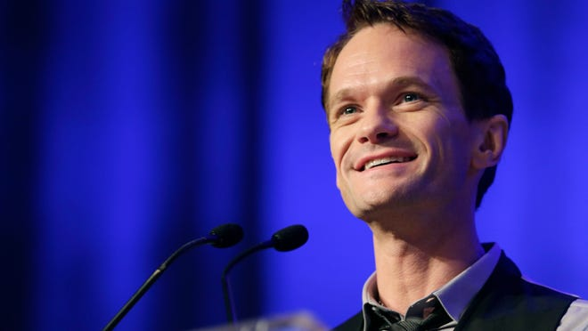 """In this May 29, 2014 file photo, actor Neil Patrick Harris speaks at Book Expo America in New York. Harris' book, """"Neil Patrick Harris: Choose Your Own Autobiography,"""" is set for release on Oct. 14, 2014."""